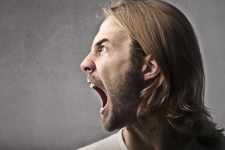 man profile: Angry young man shouting