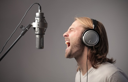 Young singer recording a song  photo