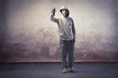 Young graffiti writer spraying paint Stock Photo - 11227081