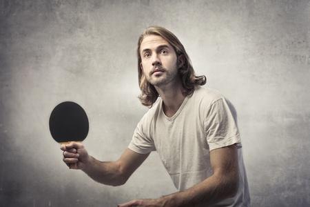 ping pong: Young man playing ping pong Stock Photo