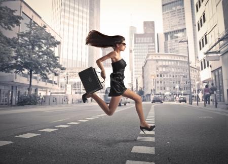 run way: Beautiful elegant woman running on a city street