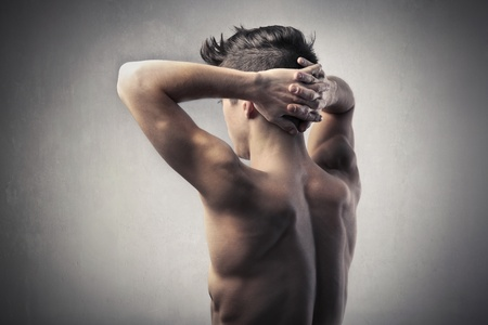 Rear view of a handsome bare-chested man photo