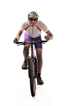 Cyclist riding a mountain bike photo
