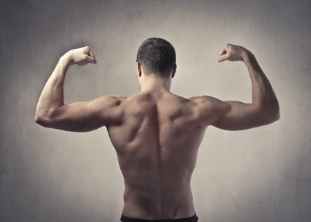 Rear view of a well-built man showing his muscles photo