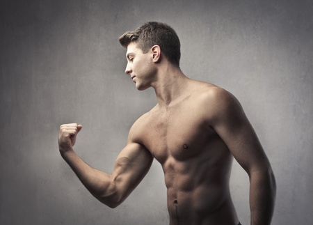 body building: Handsome bare-chested man showing his biceps Stock Photo