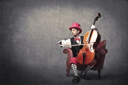 cellos: Young man playing the cello