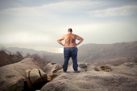 Fat man in the mountains photo