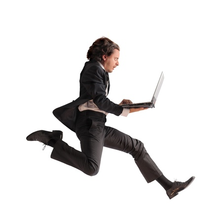 speed race: Businessman running fast and carrying a laptop