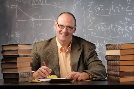 Smiling teacher in a classroom Stock Photo - 11571341