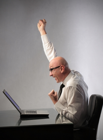 triumphing: Triumphing businessman at the office