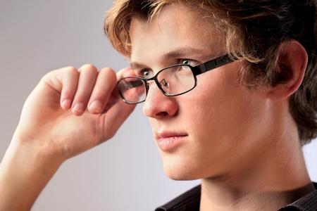 eye glass: Handsome young man wearing eyeglasses