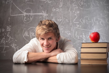 Smiling young student in a classroom Stock Photo - 11571411