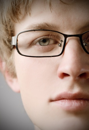man with glasses: Closeup of a young man wearing eyeglasses