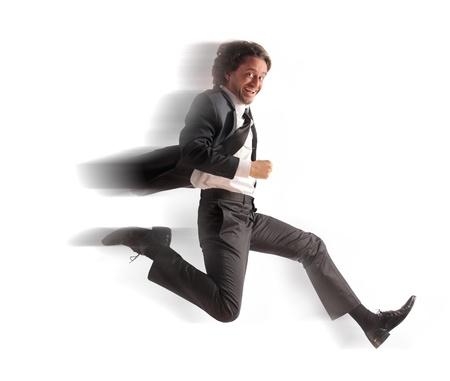 Smiling businessman running fast Stock Photo - 11571444