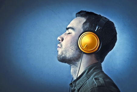 earbuds: Young man listening to music