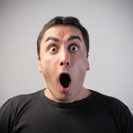 visage: Hombre joven con expresi�n at�nita Foto de archivo