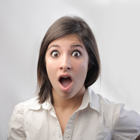 Young woman with astonished expression photo