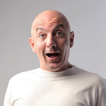 Bald man with astonished expression