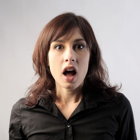 fear face: Young woman with astonished expression
