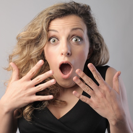 fear face: Woman with astonished expression Stock Photo