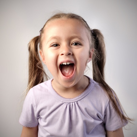screaming face: Happy little girl screaming