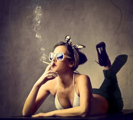 Beautiful woman smoking a cigarette Stock Photo - 11739457