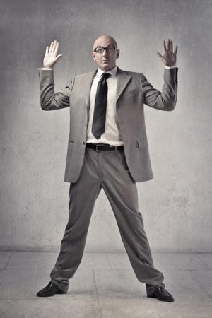Businessman raising both hands Stock Photo
