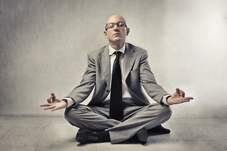 Bald businessman meditating photo