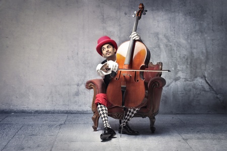 cello: Old-fashioned young indian man playing the cello