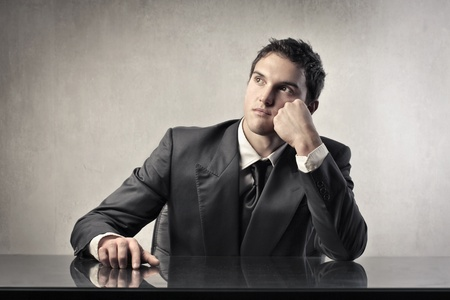 Young businessman with thoughtful expression Stock Photo - 11739472