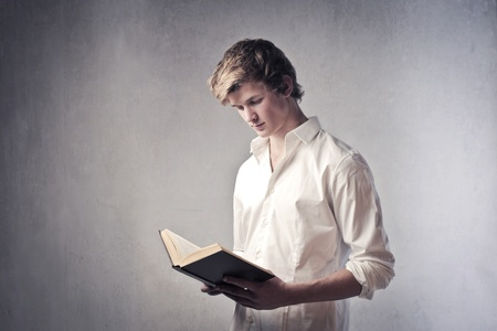 Young man reading a book Stock Photo - 11739438
