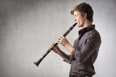 young musician: Young man playing the clarinet