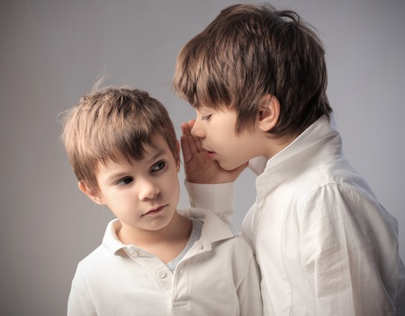 murmur: Child telling his little brother a secret