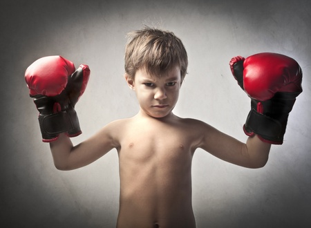 Aggressive child disguised as a boxer Stock Photo - 11905835