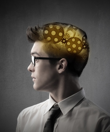 understand: Businessman with gears in his head Stock Photo