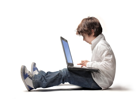 Seated child using a laptop