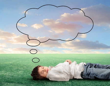 breathe: Child sleeping on a green meadow with balloon over his head