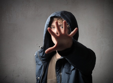 Young man hiding behind his hand Stock Photo - 11963292