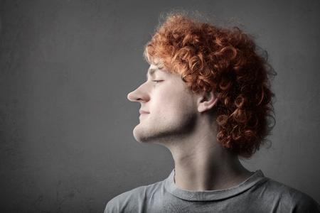 Giovane con naso lungo e mento Archivio Fotografico