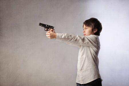 Child pointing a gun photo