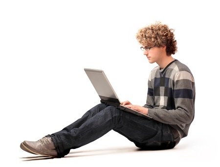 Seated young man using a laptop photo