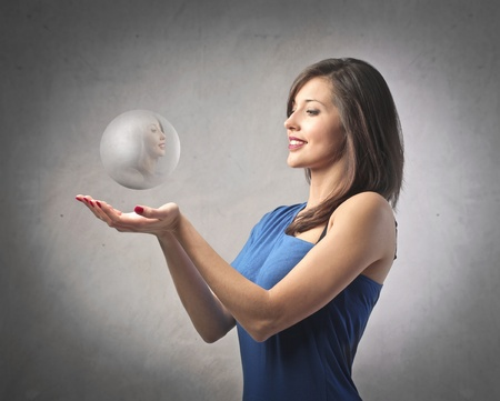 Beautiful woman holding a crystal ball photo