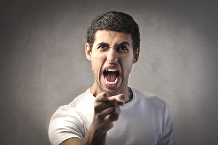 Angry man pointing his finger against someone Stock Photo - 12199677