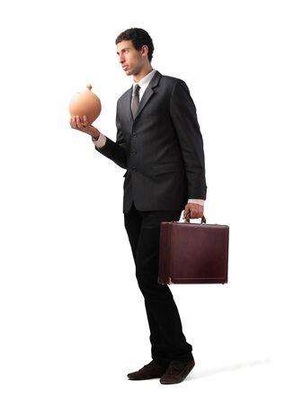 Businessman holding a money box Stock Photo - 12199160