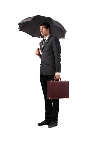 Sad businessman under an umbrella Stock Photo - 12199676