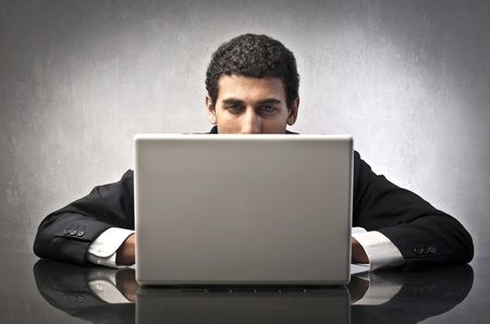 Businessman using a laptop Stock Photo - 12199682