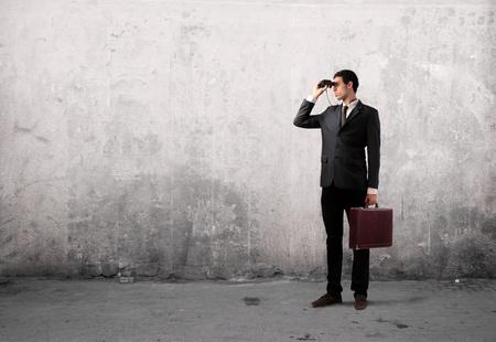 binocular: Businessman using binoculars