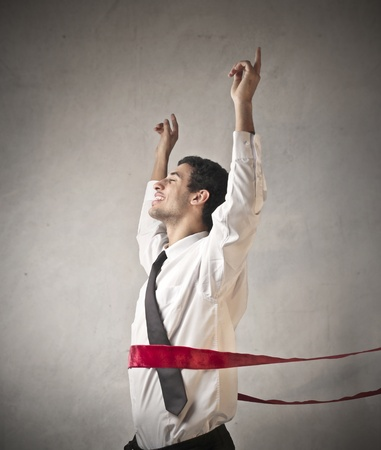 Triumphing businessman crossing the line Stock Photo - 12199684