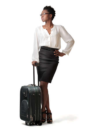 African businesswoman holding a trolley case photo