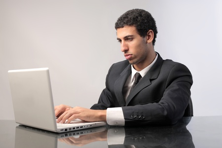 Businessman using a laptop Stock Photo - 12199728